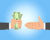 Businessman Giving Money. Hand of businessman with money giving to another guy isolated on blue background Royalty Free Stock Images