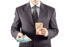 Businessman giving money Royalty Free Stock Images