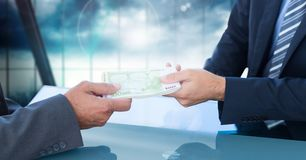 Businessman giving money to his colleague with corruption concept. Conceptual image of businessman giving money to his colleague with corruption concept stock photography