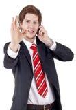 Businessman giving OK gestur Stock Images