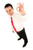 Businessman giving OK gesture. (focus on hand Royalty Free Stock Photography