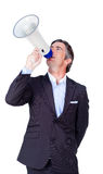 Businessman giving orders through a megaphone stock photo