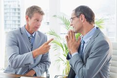 Businessman giving out to his colleague Royalty Free Stock Image