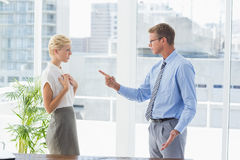 Businessman giving out to his colleague Stock Image