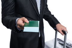 Businessman giving passport and air ticket Royalty Free Stock Image