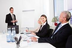 Businessman giving a presentation Stock Photo