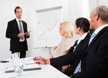 Businessman giving a presentation Stock Images
