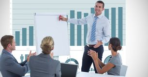 Businessman giving presentation while colleagues applauding against graph Stock Photos