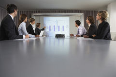 Businessman Giving Presentation In Conference Room Royalty Free Stock Photography