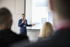 Businessman giving presentation in seminar hall at convention center Royalty Free Stock Photo