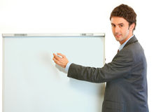Businessman giving presentation using flipchart Stock Image