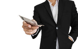 Businessman giving or receiving cash, selective focus, isolated on white background Stock Photos