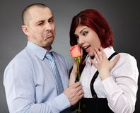 Businessman giving a rose to his partner Royalty Free Stock Photo