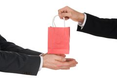 Businessman giving small bag Stock Photo