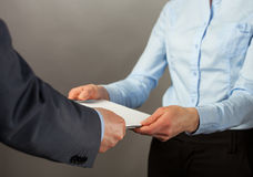 Businessman giving some documents to his secretary Royalty Free Stock Images
