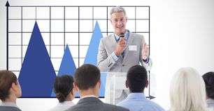 Businessman giving speech against graph. Digital composite of Businessman giving speech against graph Royalty Free Stock Photo