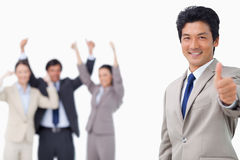 Businessman giving thumb up Royalty Free Stock Images