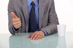 Businessman giving the thumb up. Royalty Free Stock Photo
