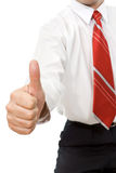 Businessman giving thumb up sign Stock Photography