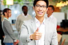 Businessman giving thumb up Stock Photo