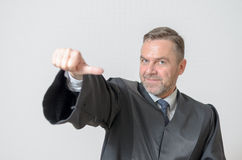 Businessman giving a thumbs to side gesture Stock Photos