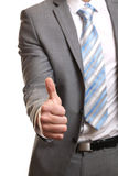 Businessman giving thumbs-up Royalty Free Stock Photo