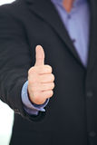 Businessman giving a thumbs up royalty free stock photos