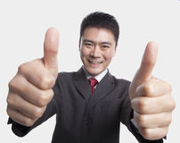 Businessman Giving Thumbs-Up Royalty Free Stock Image