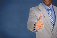 Businessman giving thumbs up Royalty Free Stock Photography