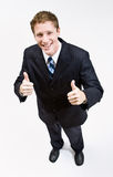Businessman giving thumbs up gesture. Towards the camera Stock Photo