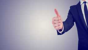 Businessman giving a thumbs up gesture in a business motivation Royalty Free Stock Image