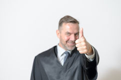 Businessman giving a thumbs up gesture Royalty Free Stock Photography