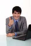 Businessman giving the thumbs up Stock Photo