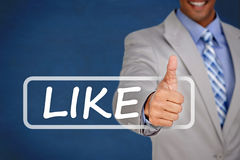 Businessman giving thumbs up with like banner Royalty Free Stock Photo