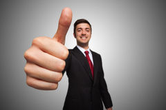 Businessman giving thumbs up royalty free stock photos