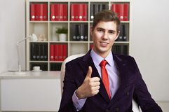 Businessman giving thumbs up Royalty Free Stock Photo