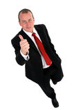 Businessman giving the thumbs-up sign. Royalty Free Stock Photos