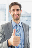 Businessman giving a thumbs up Royalty Free Stock Photography