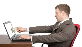 Businessman giving to laptop cash Royalty Free Stock Photo