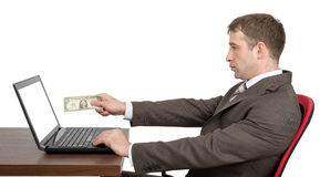 Businessman giving to laptop cash Royalty Free Stock Photos