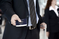 Businessman giving U.S. passport at the airport Stock Photography