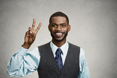Businessman giving victory, two fingers sign Stock Images