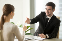 Businessman giving visiting business card to businesswoman at of Stock Images