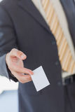 Businessman giving a white blank business card. In office Royalty Free Stock Photos
