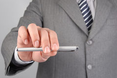 Businessman giving you the pen Royalty Free Stock Images