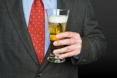 Businessman with glass of beer Royalty Free Stock Photography