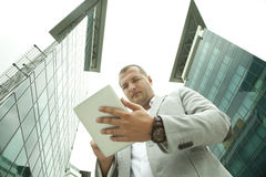 Businessman and Glass Building Royalty Free Stock Images