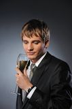 businessman with a glass of champagne Stock Photos
