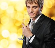 Businessman with a glass of champagne Royalty Free Stock Images