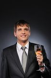 Businessman with a glass of champagne Royalty Free Stock Photography